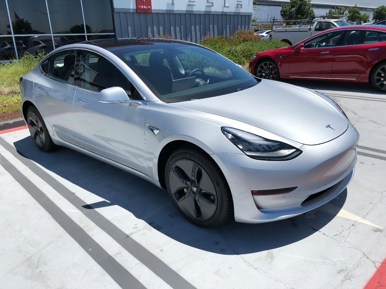 Tesla Model 3 Review Of Both The Long Range Rwd And Performance Awd With Upgrade Package